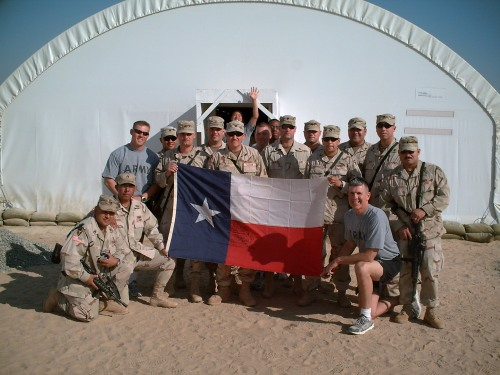 In Kuwait at the end of our deployment, December 2005. Larry Russell is standing at left, in Army PT shirt. I'm at left corner of Texas flag.