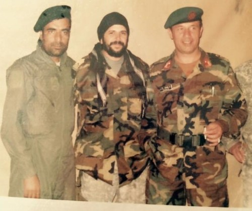 With two Afghan Army officers in Kapisa province, 2009. The soldier in green coveralls was thirty-five then, and had been fighting continuously since age fifteen. I went on many mission with him.