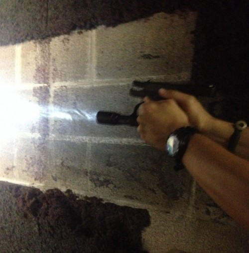 Switchback with a Glock 42, recoiling after a shot. Note that the light is still on.