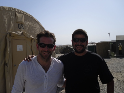 Bradley Cooper and me at my firebase in Afghanistan during a USO visit. He's about a foot taller than me, but ducked down for the picture.