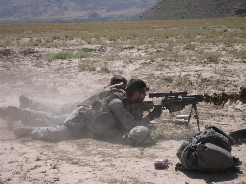 Firing a PGM .50 French sniper rifle in Afghanistan, with a French Marine sniper talking me on