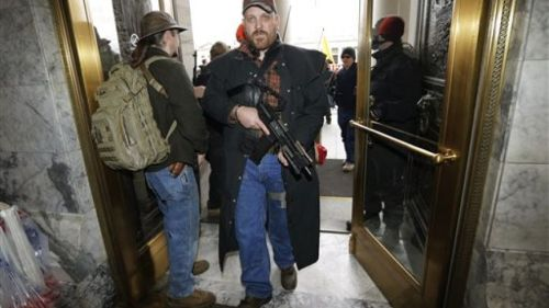 This is a totally non-threatening way to carry a weapon into a public building.