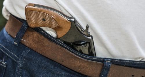 Gun-in-jeans-waistband-via-Shutterstock-800x430